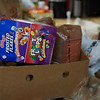 Food items pile up at the 21st Annual Rock-A-Thon to help feed those in need at the Teen Center in Gloucester, Saturday, January 13, 2018. Jared Charney / Photo