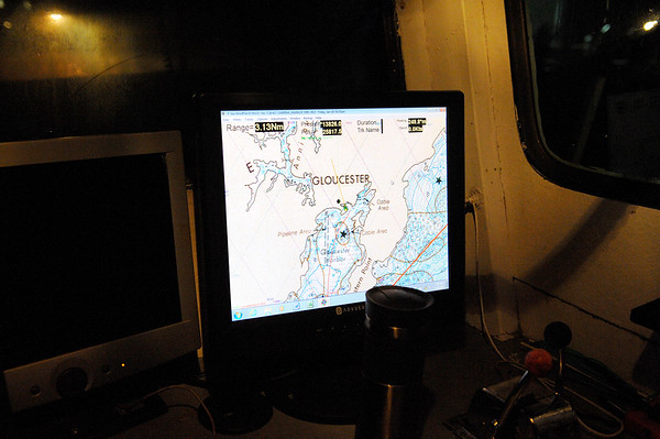 A gps screen displays a chart of Gloucester harbor where Captain Al Cottone will navigates his boat out of 3 a.m. in the morning on Friday January 19, 2018.  He will use gps and auto pilot on much of his trip so that he can focus on fishing while the boat stays on course.  He and a few other ships will take the favorable weather given to them in January to make as many runs as they can get to bring in fish.