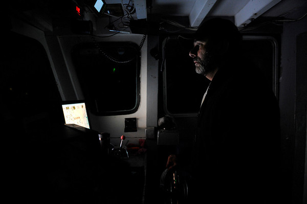 Captain Al Cottone navigates his boat out of Gloucester harbor at 3 a.m. in the morning on Friday January 19, 2018.  He and a few other ships will take the favorable weather given to them in January to make as many runs as they can get to bring in fish.