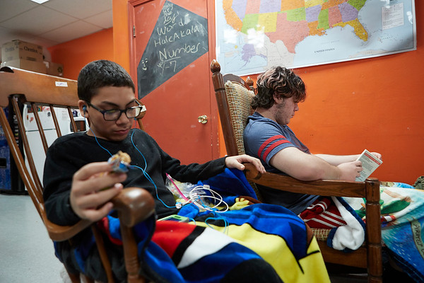 (L-R) Sam Rodriguez & Ethan Brien rock away at the 21st Annual Rock-A-Thon to help feed those in need at the Teen Center in Gloucester, Saturday, January 13, 2018. Jared Charney / Photo
