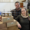 TIM JEAN/Staff photo<br /> <br /> Kristen and Dylan L'Abbe-Lindquist	owners of Pigeon Cove Ferments stand in their canning and fermenting warehouse in Gloucester. 1/29/19
