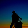 JIM VAIKNORAS/Staff photo The sun sets behind the Fisherman's Statue in Gloucester Monday evening