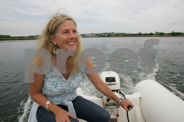 Ginger McGary McKechnie heads out to her houseboat, which was completed in 1982. Staff photo by Mary Muckenhoupt.