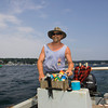 "Gloucester: Brad ""Dirt"" Murray heads out to his houseboat. For more than 30 years, Murray's life has been immersed in water, whether as a commercial fisherman or living aboard his houseboat moored in the Annisquam.<br /> <br /> Staff photo by Mary Muckenhoupt."