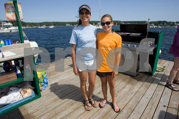 Nadina Wilk and her daughter Justine, 12, run Dirt's Dogs offering hotdogs to boaters in the Annisquam River on weekends in the summer. Mary Muckenhoupt