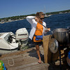 Justine Wilk, 12, serves up a hotdog from Dirt's Dogs on the Annisquam River Saturday afternoon.  Staff photo by Mary Muckenhoupt