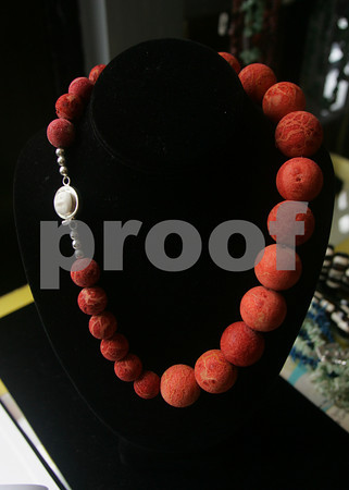 """There will always be someone looking out for your back when you wear this untreated sponge coral necklace with a carved bone face clasp. $328. Available at gallery manatee, 30 Main St., Rockport. 978-546-7245  <a href=""""http://www.renajewelry.com"""">http://www.renajewelry.com</a>."""