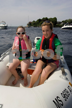 Paige Pugh, 15 of Waterford Ireland, and Aleiagh Hynds, 7, who summers in Gloucester enjoys a slush and a hotdog from Dirt's Dogs on the Annisquam Saturday afternoon. Mary Muckenhoupt/Staff Photo