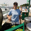 Nadina Wilk sautes some peppers  and onions, a poplar topping for the sausages she serves up at Dirts Dogs on the Annisquam River. Mary Muckenhoupt/Staff Photo