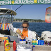 Justine Wilk, 12, puts ketchup and mustard on a hotdog from Dirt's Dogs on the Annisquam River Saturday afternoon.  Justine and her mother Nadina run Dirt's Dogs on weekends in the summer weather permitting. Staff photo by Mary Muckenhoupt