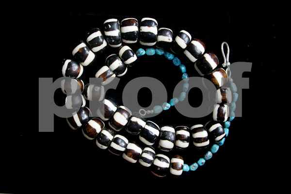 """Channel the wild zebra in yourself when you wear this painted bone and turquoise necklace. $212. Available at gallery manatee, 30 Main St., Rockport. 978-546-7245  <a href=""""http://www.renajewelry.com"""">http://www.renajewelry.com</a>"""