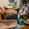 Andrew Cardone sorts through a variety of handbags he created for friends and family.<br /> Kate Glass/Staff photo