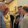 Rockport: Jon Rotenberg (center) talks with Former Judge Dave Harrison and wife Michelle and Wilbur James at his father Harold Rotenberg's  105 Birthday and Art reception at the Rockport Art Association on July 16,2010. Desi Smith Photo/Gloucester Daily Times.