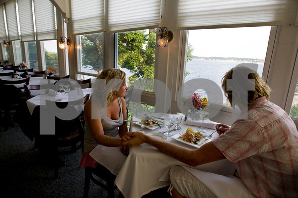 Sara Mullen and Timothy Goddard enjoy the view as they eat at Bistro 127 located in the Yankee Clipper Inn in Rockport. Photo by Kate Glass