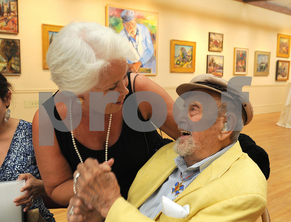 Rockport: Patricia Bertero of Gloucester, who has many of Harold Rotenberg paintings, greets him at his 105 birthday celebration and exhibit reception held at the Rockport Art Association in Rockport on July 16,2010. <br /> Desi Smith Photo