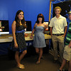 Gloucester: Art Haven's Dawn Gadow, Aja Heussi, Founder David Brooks and student Lucas Peterson stand in the computer lab area at Art Haven's anniversary/open house August 6,2010  Desi Smith/Gloucester Daily Times. August 9,2010.