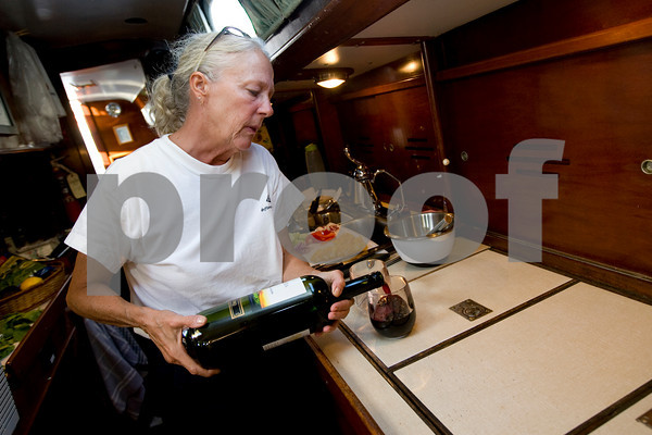 Lisa Kennedy pours a glass of wine in the galley.