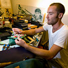 Andrew Cardone works on one of his purses.<br /> Kate Glass/Staff photo