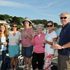 Gloucester: Party goers Camilla States, Barbra States, Mary Aarons, Ann Halstead, Linda Story and Robert Kent enjoy some drinks at the Annisquam Village Seafair. As part of a fundraiser, people could enjoy their meal on the Annisquam wooden bridge. Desi Smith Photo