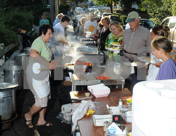 Gloucester: Karen Porter of Roy Moore Lobster and Roy Moore Fishshack serves boiled lobsters at the Annisquam Village Seafair as part of a fundraiser where people could enjoy their meal on the Annisquam Bridge. Desi Smith Photo/Gloucester Daily Times. July 30, 2010.