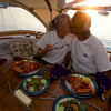 Captains Lisa Kennedy and Raffi Kassabian enjoy a lobster dinner aboard their 49-foot Hinckley, Windfall.