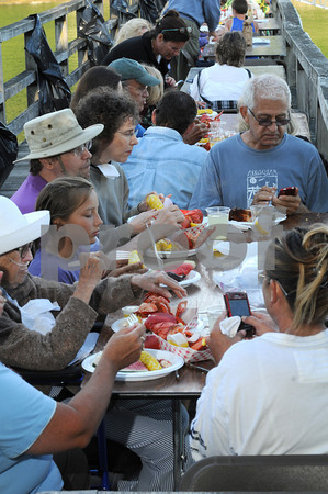 Gloucester: Right to left Jenn Neves, Terri Dee, Anna Murch-Crouse, Taylor Neves, Timothy Crouse, Andrea Shaw and Pete Erskine from NY enjoy their lobster dinner at the Annisquam Village Seafair as part of a fundraiser where people could enjoy their meal on the Annisquam Bridge. Desi Smith Photo July 30, 2010.