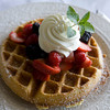 A waffle with fresh fruit and whipped cream is one of the favorites at The Grand Cafe located at the Emerson Inn in Rockport. Photo by Kate Glass