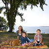 Liza Parsons helps her charges Carter, 6, and Morgan,3, Bilodeau of Swampscott get ready for a picnic at Coolidge Reservation in Manchester-by-the-Sea. <br /> Photo by Mary Muckenhoupt