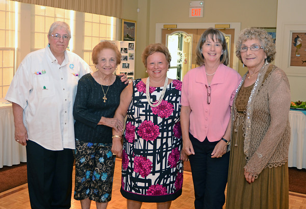 Gloucester:  Memorial Coordinator Jeanne Gallo, Gerri Lovasco, GFWA President Angela Sanfilippo, Sculptor Morgan Faulds Pike and Grace Favazza pose together at the 10th Anniversary Celebration at the Gloucester House August 4,2011. Desi Smith