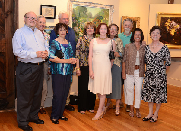 "Rockport: Members of the Rockport Art Association pose for a group photo on July 21,2011 for the exhibition titled ""Marguerite Pearson-- Hell on Wheels""  Desi Smith/Gloucester Daily Times. July 21,2011"