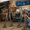 Sculptor Chris Williams welds together pieces of the legs on the metal framework of his current life-size moose project for Simon Malls in his studio at 22 Rocky Hill Road, Essex, Mass. Photo by Brianna Healy.
