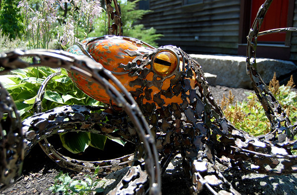 An octopus made from stainless steel and blown glass by Chris Williams outside of his studio at 22 Rocky Hill Road, Essex, Mass. Photo by Brianna Healy.