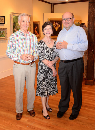 """Rockport: Present Treasurer Ted Mee, (check Ted's last name) Carol Linsky and Former Treasurer Walter Manninen at the Rockport Art Association on July 21,2011 for the exhibition titled """"Marguerite Pearson-- Hell on Wheels""""  Desi Smith/Gloucester Daily Times. July 21,2011"""