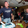 Gloucester:  Captain Kevin Leonowert looks at one of the Captians and smiles as he makes the first cut in the cake as they celebrate Season 1 finale and the success of the show Sunday night at the Crows Nest.   Desi Smith/Gloucester Daily Times. June 3,2012