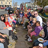 Desi Smith/Cape Ann Magazine<br /> Parents and children sit on hale bales in wagon pulled by a tractor driven by Ken Lane of Rockport's SeaVeiw Farm at last year's Rockport HarvestFest. This year's event will be Saturday, Oct. 13.