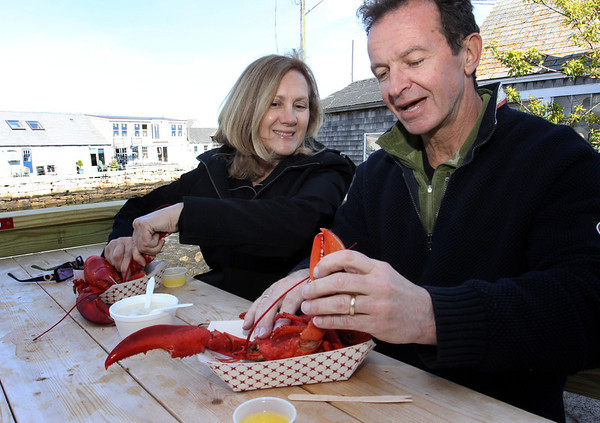 ALLEGRA BOVERMAN/Cape Ann Magazine Sue and Peter Andersen of Rockport eating lobster together at Roy Moore's Lobster Shack in Bearskin Neck, Rockport.