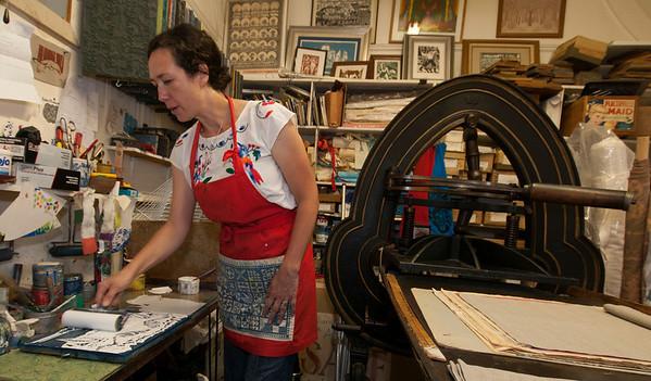 Jim Vaiknoras/Cape Ann Magazine: Julia Garrison inks a printing block inside of The Sarah Elizabeth Shop in Rockport