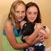 ALLEGRA BOVERMAN/Cape Ann Magazine. At the 40th Birthday Party for State Rep. Ann-Margaret Ferrante at Cruiseport on June 22. Brooke Hill, left, and her friend Sophia Wulsin, both 8, both of Lowell, with Roxie, Sophia's minature teacup pig. Wulsin's family are close friends of Ferrante.