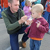 Essex:  Eric Wilder of Beverly gives his son Daniel 3, a taste of some clam chowder the Annual Clam-Fest held at Memorial Park Saturday afternoon in Essex, as his daughter Elizabeth 6, in pink behind samples hers.  Desi Smith/Gloucester Daily Times. October 22, 2011