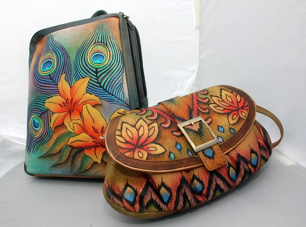 ALLEGRA BOVERMAN/Cape Ann Magazine Anushchka leather backpack, $270; Anushchka leather purse, $190. Both handpainted in India. Bearskin Neck Leathers.