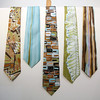 "ALLEGRA BOVERMAN/Cape Ann Magazine. Hand-painted 100 percent silk ties by Adriana ""Gigi"" Mederos of Aquatro Gallery in Rocky Neck. From left: ""Earth Geo,"" $95, ""Aqua Stripe,"" $75, ""Geek Chic,"" $87, ""Chlorophyll,"" $75, ""Brown Stripe,"" $75."