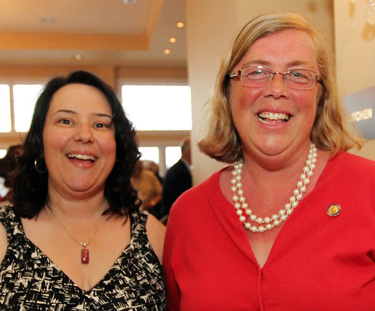 ALLEGRA BOVERMAN/Cape Ann Magazine. At the 40th Birthday Party for State Rep. Ann-Margaret Ferrante at Cruiseport on June 22. Ferrante, left, and Mayor Carolyn Kirk.