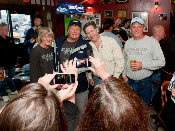 Gloucester:  Owner of Causway Liquor's Jamie Burnham center gets his photo taken with from left Donna and Bill Monte of Bounty Hunter and Captain Ralph Wilkins of Odysea on right, at the Crows Nest Sunday night.  Desi Smith/Gloucester Daily Times. June 3,2012