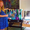 "Courtesy photo/Cape Ann Magazine. Stephanie Terelak and her Parsons table titled ""When the dust settles."" Her artist statement: ""Growing up on the sea, we often painted en plein air, working to capture the ever-changing light and atmosphere in the landscape,"" Terelak says.  ""When I moved to New York City, I struggled on my own to understand the absence of the natural landscape, in sharp contrast to what I had painted previously. I realized that the instability of the environment was what fascinated me most -- whether it is the formidable storms that approach from the sea, or man-made destruction that I witnessed in Manhattan, what was once before your eyes can disappear in an instant."""