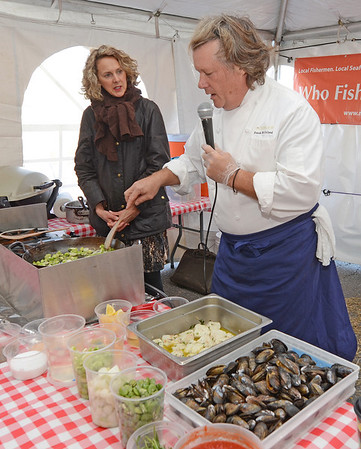 Chef Frank McClelland of Boston's L'Espalier and owner of Apple Street Farm in Essex shows Rockport resident Heather Atwood and visitors at the Rockport Harvest Fest how to prepare a fish stew last year. McClelland is just one of the chef who will be at the festival doing cooking demos.