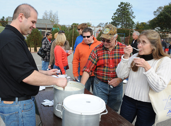 Essex:   Barbara Low of Essex samples some chowder from La Rosa's in Gloucester at the Annual Clam-Fest held at Memorial Park Saturday afternoon in Essex.  Desi Smith/Gloucester Daily Times. October 22, 2011