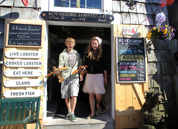 ALLEGRA BOVERMAN/Cape Ann Magazine Ethan Andersen and Emily Arntsen with live lobsters at Roy Moore Lobster Shack in Bearskin Neck, Rockport.
