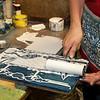 Jim Vaiknoras/Cape Ann Magazine: Julia Garrison inks a printing block inside of The Sarah Elizabeth Shop in Rockport.