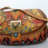 ALLEGRA BOVERMAN/Cape Ann Magazine Anushchka leather purse, handpainted in India. $190, Bearskin Neck Leathers.