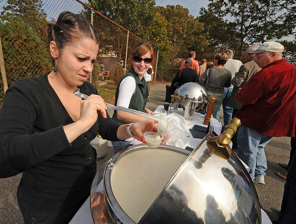 Essex:   Jessi Kellner and Heather Counselman  fill cups with clam chower for The Landing at 7 Centrial Manchester as first year competitors in the Annual Clam-Fest held at Memorial Park Saturday afternoon in Essex.  Desi Smith/Gloucester Daily Times. October 22, 2011